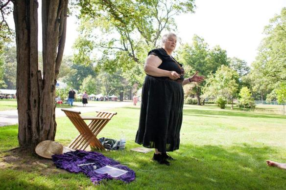 """An instructor who goes by Tchipakkan, whose means ""dance of the dead"" and is a word for the Aurora Borealis, teaches a group about dowsing and kinesiology at the Southern New Hampshire Pagan Pride Day at Rollins Park in Concord on Saturday, Sept. 6, 2014."" (JULIE BYRD-JENKINS / Monitor staff)"